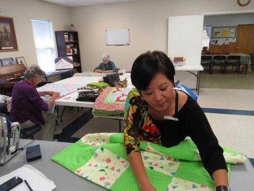 Hong Alexander irons a quilt-in-progress during a Nov. 4, 2015 meeting of the Women's Fellowship at Poetry United Methodist Church, in Poetry, Texas. UMNS photo by Sam Hodges
