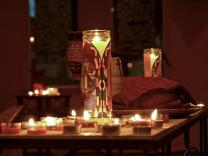 Candles flicker at Wellspring UMC in Tampa, Fla. Photo by Derek Maul.