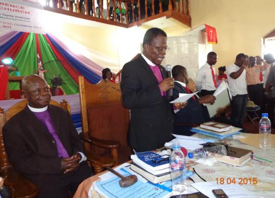 Liberian Bishop John G. Innis announces the results of a vote on overturning a bar to divorced clergy seeking the office of bishop. The vote, taken during the 182nd session of the Liberia Annual Conference, was 433 to 24 to keep the bar. Photo by Julu Swen UMNS