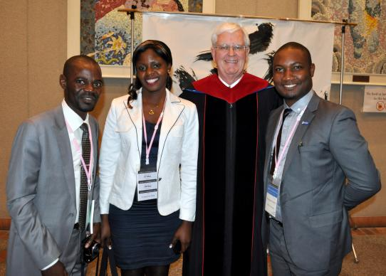 Bishop James E. Dorff (second from right) visits with the Africa University student delegation, Ivan Milosi Mumba, Esther Ojong Ntui and Munashe Hashiti during the 2014 International Association of Methodist Schools, Colleges and Universities held in Hiroshima, Japan. Photo by Kimberly Lord, General Board of Higher Education and Ministry