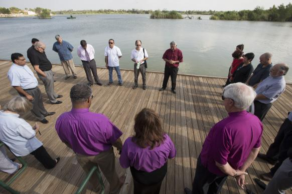 A delegation of United Methodist and other church leaders prays together on the U.S. shore of the Rio Grande at Anzalduas Park in Mission, Texas, directly across the border from Reynosa, Mexico. The group is holding a strategy meeting to learn more about the border crisis and improve the United Methodist response.  Photo by Mike DuBose, UMNS.