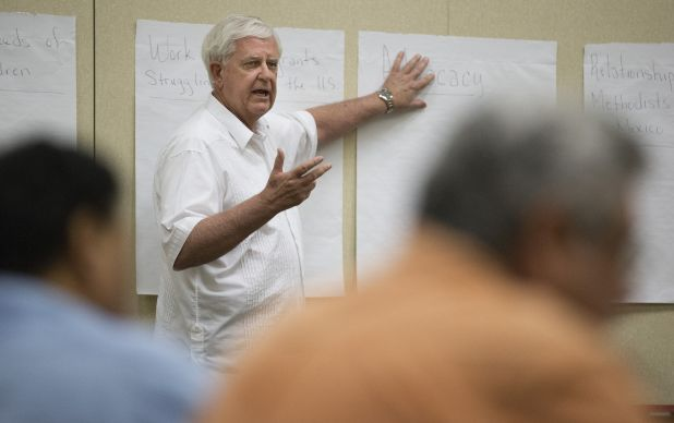 Bishop James Dorff helps conduct a strategy session on United Methodist response to the recent influx of immigrants from Central America at First United Methodist Church in McAllen, Texas. Photo by Mike DuBose, UMNS.