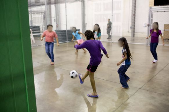 On August 18, a United Methodist delegation got to see, but not visit with, these unaccompanied minors held by the Border Patrol at the recently-opened Rio Grande Centralized Processing Center in McAllen, Texas. The Border Patrol provided this photo, altering it to protect the identity of the minors.; Courtesy of U.S. Border Patrol