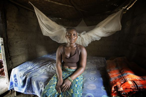 Fanta Josiah sits in front of the insecticide-treated mosquito net she received from the United Methodist Church's Imagine No Malaria campaign in 2010 at her home in Bumpe, near Bo, Sierra Leone. The insecticide in nearing the end of its useful life and several villages in the Bo district will receive new nets from the campaign in the first planned redistribution to replace the nets given in 2010. Photo by Mike DuBose, UMNS