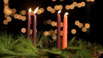 An Advent wreath with four lit candles represents the fourth week of Advent.  Photo by Kathleen Barry, United Methodist Communciations