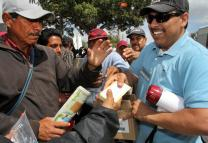 The Rev. Saul Montiel, a U.S. - Mexico border missionary, distributes health kits at the Plaza el Bordo in Tijuana. Montiel led one of the four groups of United Methodist bishops from all over the world who came to visit the U.S. - Mexico border on May 7, 2013. Photo by Kathleen Barry, UMNS; Photo by Kathleen Barry, UMNS