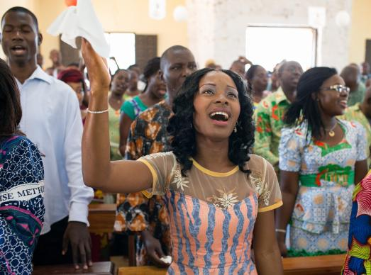 Claudia Teli N'guessan sings during worship at during worship at Temple Emmanuel United Methodist Church in Man,  Côte d'Ivoire. Photo by Mike DuBose, UMNS