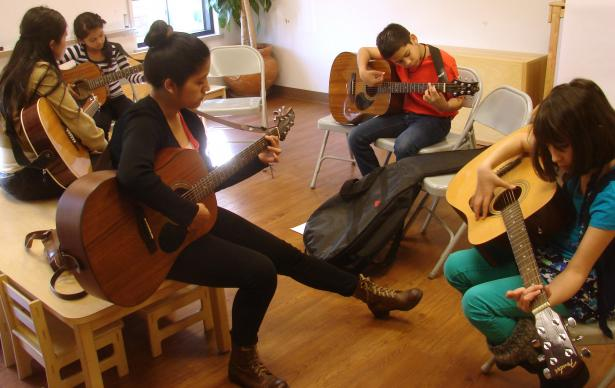 Coral Romero (left) and Adriana Campos (center) are youth band members at Christ's Foundry United Methodist Church who teach guitar there on Sunday afternoons. Photo by Sam Hodges, UMNS.
