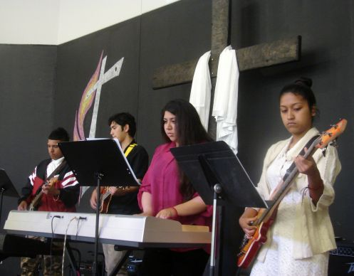 At Christ's Foundry United Methodist Church, youth band members help lead worship and teach music to kids on Sunday afternoon. Some of the members include (from far left) Manuel Campos, Dylan Santana, Berenice Baeza and Adriana Campos. Photo by Sam Hodges, UMNS.