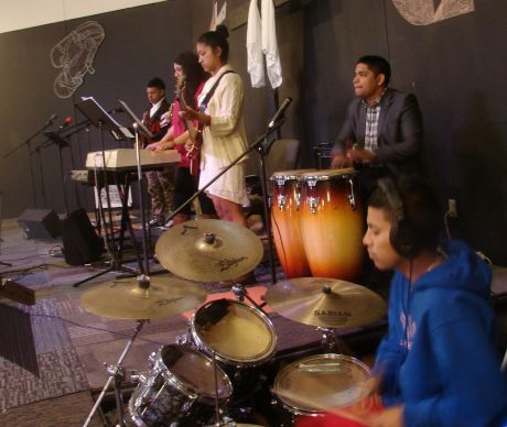 The youth band at Christ's Foundry United Methodist Church has branched out from guitar to a range of instruments. Raymundo Campos is the lead drummer, assisted here by Oscar Lopez, who usually plays bass. Photo by Sam Hodges, UMNS.