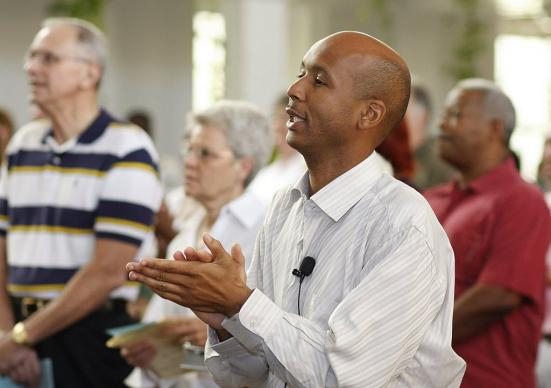 Ronald Southall joins in the singing during worship service at First Grace United Methodist Church. A UMNS photo by Kathy L. Gilbert.; A UMNS photo by Kathy L. Gilbert