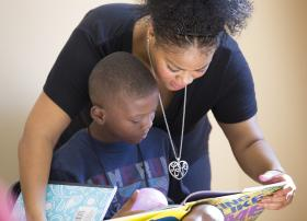 An adult and child read together at a Freedom School in Nashville, TN.