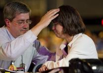 The Rev. Dan Dick (left) and Lisa King pray together during evening worship at the 2012 United Methodist General Conference in Tampa, Fla. A UMNS photo by Mike DuBose.; Mike DuBose, UMNS