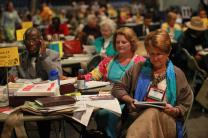 Delegate Tammy Estep from Virginia bows her head in prayer prior to the start of the Monday April 30 plenary at the 2012 United Methodist General Conference. Photo by Kathleen Barry, UMNS