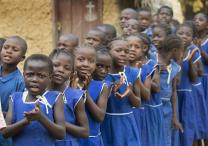 A children's choir welcomes visitors to Fulawahun village near Bo, Sierra Leone. Several villages in the Bo district will receive new, insecticide-treated mosquito nets from the United Methodist Church's Imagine No Malaria campaign in the first planned redistribution to replace nets given in 2010. Photo by Mike DuBose, UMNS