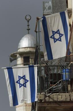 Israeli flags fly from a home near a Moslem mosque inside Jerusalem's ancient walled city. Photo by Mike DuBose, UMNS