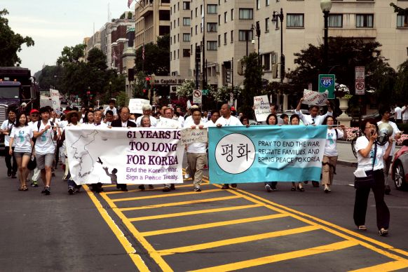 "Walking the route from Foundry United Methodist Church to the White House, marchers shout, ""Peace for Korea Now!"" while holding signs and banners during a Korean Peace March on July 26, 2014. Photo by Jacob Lee, UMNS"