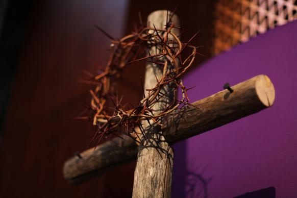 A Lenten display features a crown of thorns and cross with purple cloth.  Photo by Kathleen Barry, UMNS.
