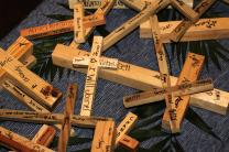 A table filled with small crosses presents participants at Brentwood United Methodist Church to literally