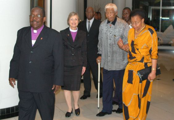 Bishop Janice Huie escorts Nelson Mandela and his wife, Gracia Machel, as Bishop João Somane Machado leads the way. A UMNS 2006 file photo by Stephen Drachler. Accompanies UMNS story #183.  6/10/13.; A UMNS 2006 file photo by Stephen Drachler