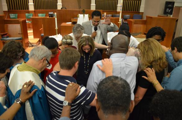 Members of  McKendree United Methodist Church pray over Alison Weakley prior to her departure on a mission trip to Africa. The Rev. Stephen Handy leads the prayer in Nashville, Tenn.  Photo courtesy of McKendree United Methodist Church