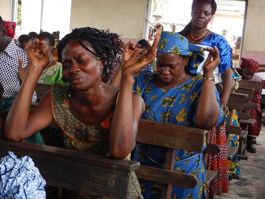The church building of Nouvelle Jerusalem Port-Bouet 2 (New Jerusalem United Methodist Church) in Côte d'Ivoire, was partially destroyed by a government project to build a larger road. Despite the damage, church members continue with Sunday worship on September 28, 2014. Photo by Isaac Broune, UMNS