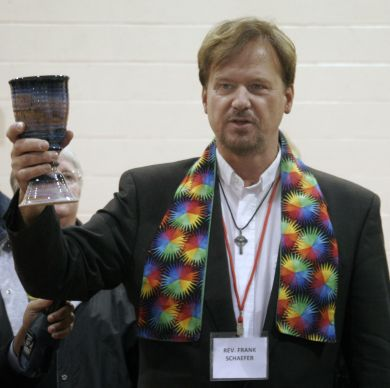Rev. Frank Schaefer serves Communion to his supporters at the end of his two-day church trial held Nov. 18-19, 2013 in Spring City, Penn.