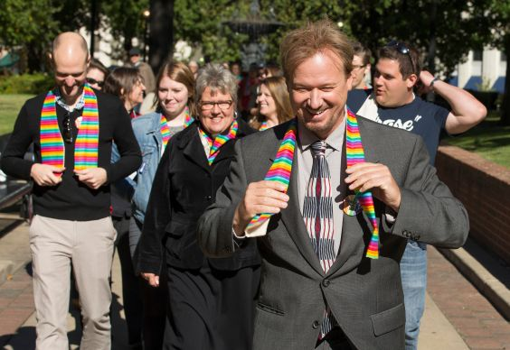 The Rev. Frank Schaefer (right) leads a procession of supporters from Court Square Park in Memphis, Tenn., on the way to his appearance before the United Methodist Judicial Council. Rev. Schaefer lost his standing in the denomination's Eastern Pennsylvania Conference after being found guilty in a church trial last November of performing a same-sex wedding ceremony for his son, Tim (left). The question of whether an appeals committee was correct in restoring Schaefer's clergy credentials was argued Wednesday, Oct. 22, before United Methodism's top court. Photo by Mike DuBose, UMNS