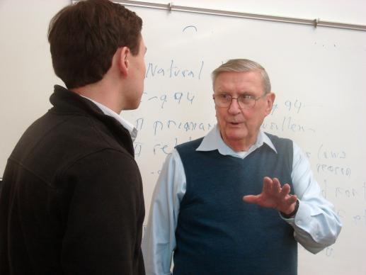 Peter Norton, a second-year student at Perkins School of Theology at Southern Methodist University in Dallas, confers with the Rev. Charles Curran after a recent class in moral theology.