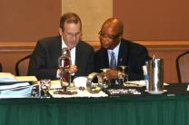 Don House, at left, chair of the South Central Jurisdiction's episcopacy committee, talks with Bishop W. Earl Bledsoe during a break in the hearing to determine whether the committee votes to place Bledsoe in involuntary retirement. Photo taken July 17, 2012 in Oklahoma City. A UMNS photo by Heather Hahn.