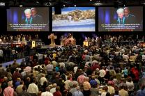 Delegates and visitors fill the plenary hall in the May 1 afternoon celebration of Pan-Methodist Full Communion at the 2012 United Methodist General Conference in Tampa, Fla. On the screen are Bishop Sharon Rader and Bishop John White. A UMNS photo by Kathleen Barry.