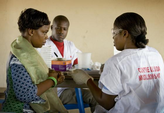 Cecile Ahimin Aya (left) has an HIV test during a public health screening at the Jerusalem Parish United Methodist Church in Yamoussoukro, Côte d'Ivoire, in this November 2008 file photo. The book, Religion and AIDS in Africa, by professors Jenny Trinitapoli and Alexander Weinreb, explores the role religious communities have come to play in both the prevention and treatment of HIV/AIDS. A UMNS file photo by Mike DuBose. Accompanies UMNS story #089. 3/27/13..; A UMNS file photo by Mike DuBose