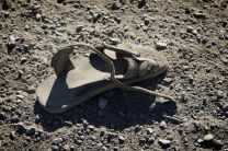 In recent months, the numbers of unaccompanied minors from Central America crossing the U.S. border has surged, drawing both concern and criticism. In this file photo, an abandoned sandal lies just across the border from Mexico near Friendship Park in San Diego. Photo by Mike DuBose, UMNS.