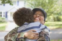 Excited returning soldier hugging her son. Photo by Blend Images - Kidstock / gettyimages.com