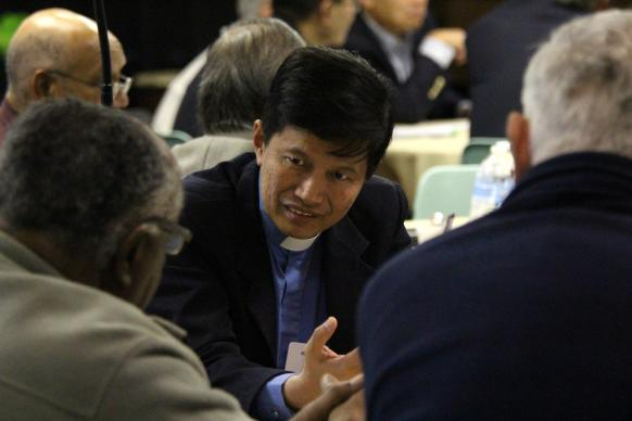Bishop Pete M.Torio from the Philippines leads a small group discussion during the 2013 Council of Bishop meeting held at Lake Junaluska.