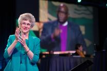 Bishop Peggy A. Johnson (left) interprets Bishop Gregory V. Palmer's episcopal address into American Sign Language at the 2016 United Methodist General Conference in Portland, Ore. Photo by Mike DuBose, UMNS