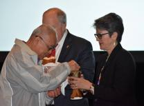 Bishops Leo Soriano (left), Mike McKee and Sally Dyck participate in Communion on February 27.
