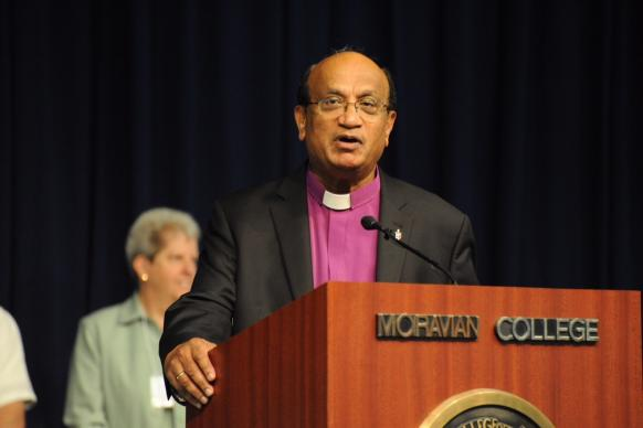 Bishop Sudarshana Devadhar of the New England Conference speaks following the passsage of the resolution.