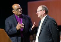 Bishop Sudarshana Devadhar (left) of the Boston Episcopal Area welcomes the Rt. Rev. Chris Giesler, representing the Moravian Church Northern & Southern Provinces, to the 2016 United Methodist General Conference.