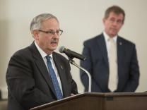 Bishop Bruce Ough (left) speaks during the oral hearing of the Judicial Council meeting on May 22, 2018. Also pictured (right), Bishop Scott J. Jones of the Texas Conference.