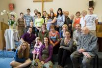 The Doyle family – Barry (second row, left, in purple shirt), Faith and Kathy (front row, left) join members of their  congregation's sister church in the Czech Republic for a picture.