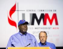 """Bishop James E. Swanson Sr. (left), president, and Gil Hanke, general secretary of the General Commission on United Methodist Men, introduce the """"Missing in Action"""" video to the 2016 General Conference."""