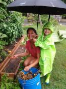 Irene and Nathan David, from the Philippines, work in the community garden at Highland United Methodist Church, Raleigh, N.C.
