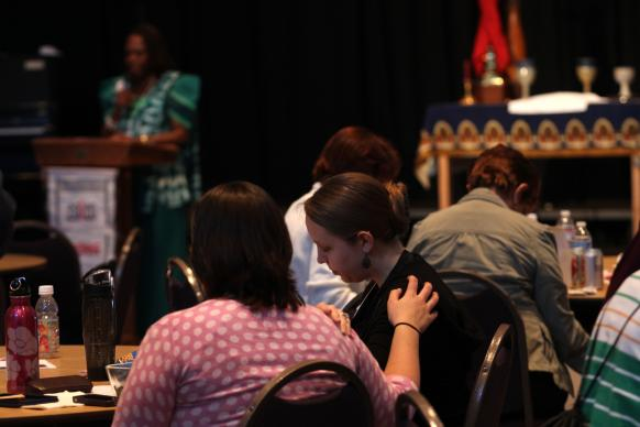 Participants pray during the HIV/AIDS seminar that preceded the opening  of General Conference 2012 in Tampa, Florida. A similar event on May 9 willl precede General Conference 2016 in Portland, Oregon