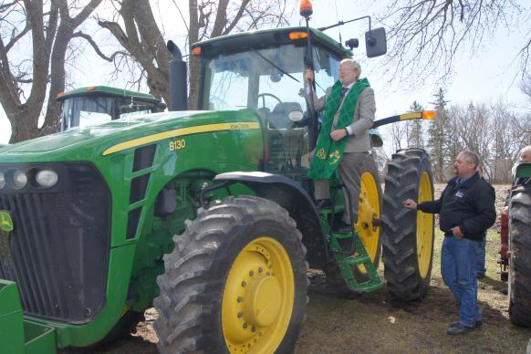 The Rev. Joel Xavier includes prayers for a good harvest, safety and all who are part of the farm economy during the annual Blessing of the Tractors at Pleasant Corners United Methodist Church in Minnesoa.
