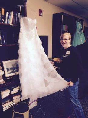 Volunteer Sam Penwell steams a dress.