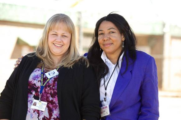 """When in doubt, love people,"" says Erin Wagner (left), an ex-offender whose ministry passion is sharing Christ with prisoners. Here, she stands with Kimberly Campbell, chaplain at the prison where Wagner was once incarcerated and now volunteers."