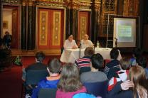 The Rev. K Karpen and Rabbi Roly Matalon speak to children at B'nai Jeshurun Hebrew School in New York City.