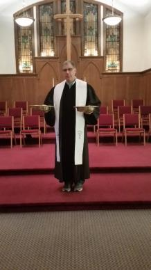 While the Rev. Richard Burstall promotes the availability of online giving at Michelson Memorial United Methodist Church, receiving gifts in the traditional plates is still a part of each service.