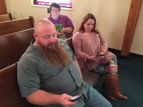(From left) Jim Huston, Bronwyne Butler and Frieda Brown use the YouVersion app on their smartphones and tablets during Bible study at East Cobb United Methodist Church.